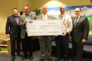 Presenting the check were Lea's Foundation Board Members Dan Nolan (second from left), Nicholas Stamboulis (center), and David Archilla, Chairman of the Board (right). Accepting the donation on behalf of Connecticut Children's were Connecticut Children's Foundation President David Kinahan (left), and Michael Isakoff, MD, Clinical Director of Connecticut Children's Hematology/Oncology Division (second from right).